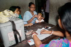 Let's eradicate polio. An Indian woman is giving polio drops to a child at 'Sunday Pulse polio center' in Kolkata, India. Pulse Polio is an immunisation Royalty Free Stock Images