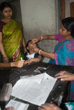 Let's eradicate polio. An Indian woman is giving polio drops to a child at 'Sunday Pulse polio center' in Kolkata, India. Pulse Polio is an immunisation Stock Photo