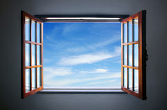 Let the blue sky in. Wide open rustic window showing a blue sky outside Royalty Free Stock Images