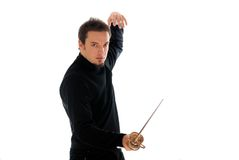 Let the duel begin. Photograph of a fencer with his sabre. Duel abstract Royalty Free Stock Photo