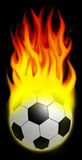 Let the games begin!. A burning soccer ball over black background Stock Image