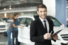 Let me assist you in your vehicle search. Handsome young classic Stock Image