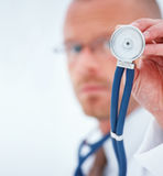 Let me check - Doctor using  stethoscope Stock Photos