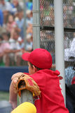 Let me in coach. Little league player waiting to get into the game stock images