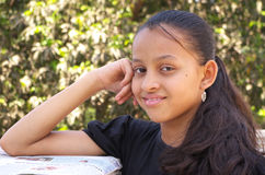 Let me not tell you this. A smart Indian teenage girl with a mischievous smile Stock Image