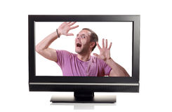 Let me out. Person struggling to escape from inside a TV Royalty Free Stock Photo