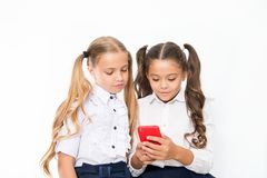 Let me show you something interesting. Educational application. Online entertainment concept. Schoolgirls cute pupils stock photos