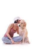 Let me tell you a secret. Girl and a Labrador retriever isolated against white background Stock Images