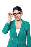 Let me think about it !. Image of a business woman adjusting her eye glasses Royalty Free Stock Images