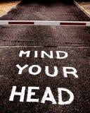 Let op uw hoofd stock afbeelding