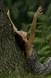 Let it rain!. Beautiful woman enjoying rain in a wood. Concept: contact with nature Royalty Free Stock Images
