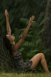 Let it rain!. Beautiful woman enjoying rain. Concept: contact with nature Royalty Free Stock Images