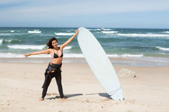 Let's catch some waves!. Beautiful young woman preparing to another day of surf Royalty Free Stock Image