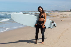 Let's catch some waves!. Beautiful young woman preparing to another day of surf Stock Photo