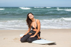 Let's catch some waves!. Beautiful young woman preparing to another day of surf Stock Photos