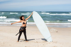 Let's catch some waves!. Beautiful young woman preparing to another day of surf Royalty Free Stock Images