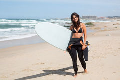 Let's catch some waves!. Beautiful young woman preparing to another day of surf Stock Photography