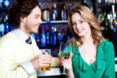 Let's celebrate. Young couple at nightclub Royalty Free Stock Images