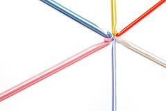 Let's Crochet. Colorful crochet needles in a spoke-like pattern Stock Images