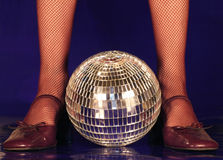 Let's dance. Old dance shoes & a mirror ball stock images