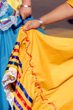 Let's Dance!. Young Girl's Hand Holding Out Orange Ethnic Mexican Dress Stock Image