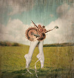 Lets dance. Fantasy artistic image that represent feet tiptoe and calves of a classic ballerina in a ballet slippers with a surreal mechanism of gears that Royalty Free Stock Image