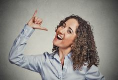 Let's drink hand gesture. Portrait happy silly goofy woman gesturing showing with hand thumb to go out party get drunk isolated grey background. Positive human Stock Photography