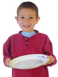 Let's Eat!. Boy holding out a plate Royalty Free Stock Image