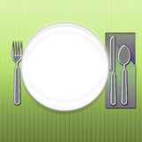 Let's Eat. Dinner setting with green cloth and white plate space for copy - can be used as navigation or message area Stock Photography