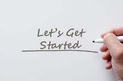 Let's get started written on whiteboard Royalty Free Stock Photo