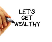 Let's get wealthy. Closeup of a hand writing a let's get wealthy message with a marker, possibly for a business strategy, isolated on a white background Royalty Free Stock Images