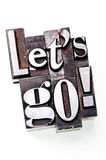 Let's Go!. The phrase Let's Go! in letterpress type. Cross processed, narrow focus Royalty Free Stock Images