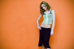 Let's go.. Young woman ready to go out wearing party clothes, strikes a bold pose.  Horizontal orientation Royalty Free Stock Image