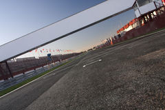 Let�s go!. A view from the pole position in a racetrack. You can put your sign and text over the road Royalty Free Stock Photography