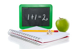 Let's go back to school. And snack healthy isolated over a white background Royalty Free Stock Photos