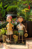 Let's go gardening. Couple of boy and girl in a story of flirting, persuding for gardening, a girl is shy to say yes, implying that she is also like the boy Stock Photography