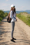 Let's go hiking. Beautiful young brunette woman hiking in beautiful landscape Stock Photography