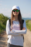 Let's go hiking. Beautiful young brunette woman hiking in beautiful landscape Royalty Free Stock Image