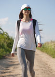 Let's go hiking. Beautiful young brunette woman hiking in beautiful landscape Royalty Free Stock Images