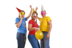 Let's go party. Group of friends wearing party masks and hats posing over white Royalty Free Stock Images