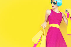 Let's go shopping!Glamorous fashion lady. Let's go shopping! Glamorous fashion lady  on yellow background Stock Photo