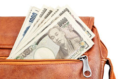 Lets go shopping. Hand bag Closeup with Japanese Yen banknotes as a symbol for ready to shopping in Japan Stock Photos
