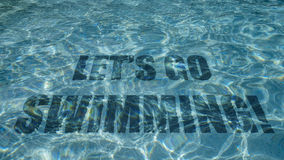 Free Let S Go Swimming Text Appearing Under Water In A Swimming Pool Royalty Free Stock Images - 56749399
