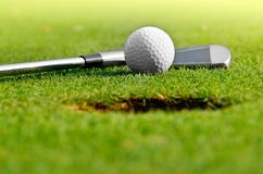 Let's golf. Close up of a golf ball on the grass Royalty Free Stock Photo