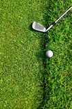 Let's golf. Close up of a golf ball on the grass Stock Image