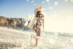 Let`s hit the waves. Beauitful young surfer girl running to the waves with her surfboard Royalty Free Stock Images
