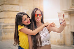 Let`s make a funny selfie! Stock Photos