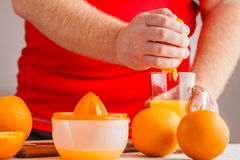 Let's make orange juice by squeezer royalty free stock photography