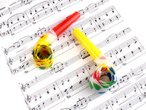 Let's make some noise. Party blowers on music sheet Stock Images