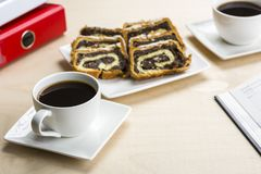 A break at work - time for something sweet. Let`s meet in the office with coffee and cookies Royalty Free Stock Photo